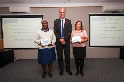 Technology award winners receive their award from Ian Stidston Accountable Officer